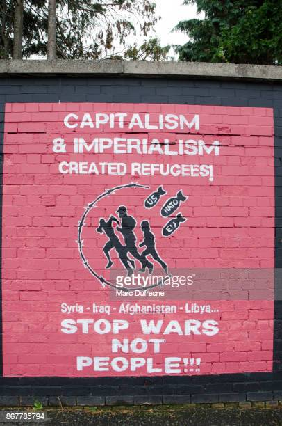 wall painting mural against war, capitalism and imperialism in belfast during day of autumn - imperialism stock pictures, royalty-free photos & images