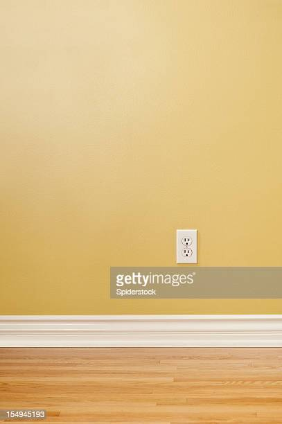 wall plug in empty room - wainscoting stock photos and pictures