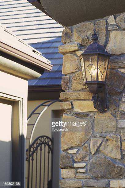 Wall sconce on exterior stone wall