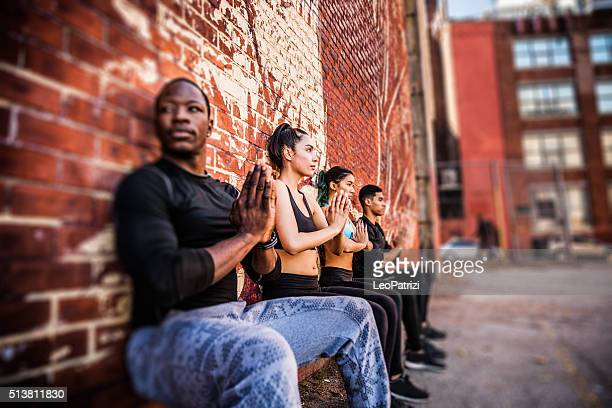 Wall sitting exercise urban outdoor gym in NYC