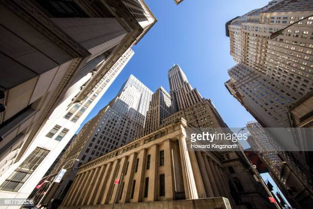 wall street and financial district, wide angle view looking up - ウォール街 ストックフォトと画像
