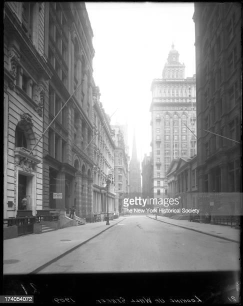 Wall Street looking west toward Trinity ChurchNew York New York late 1900s