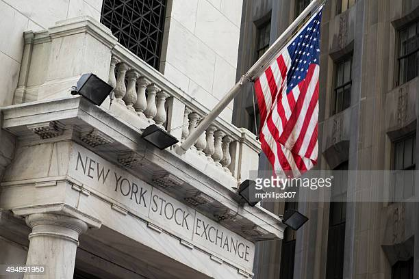 wall street new york stock exchange - bull market stock pictures, royalty-free photos & images