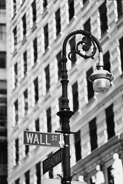 Signs indicating the intersection of Wall Street and...