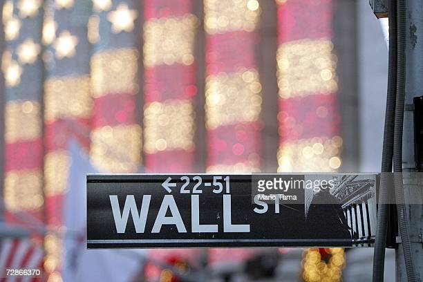 Wall Street sign is seen in front of the New York Stock Exchange December 21 2006 in New York City Wall Street's top financial firms' soaring profits...