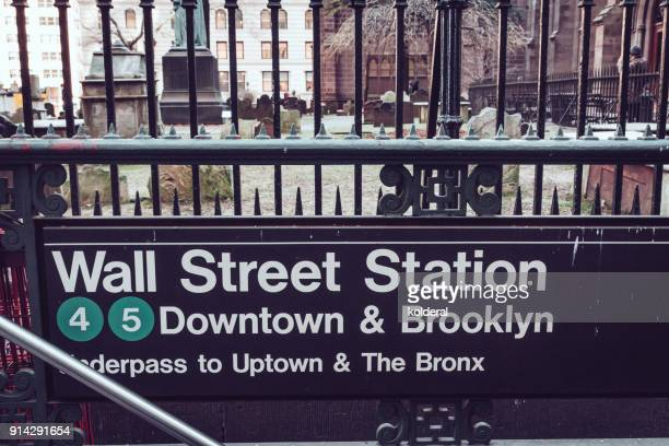 wall street subway station entrance in lower manhattan - entrance sign stock photos and pictures