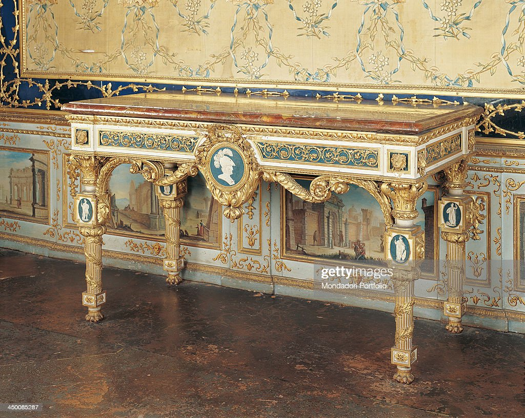 Italy, Piedmont, Stupinigi, Palazzina di caccia. Whole artwork view. View of a piece of forniture of the Palazzina di caccia, a wall table made of carved wood; the frontal flank shows medallions with white human figures or a head wearing an helmet wi : News Photo