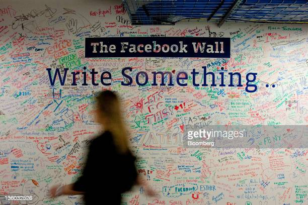 A wall that has been written on by employees stands in the entry way at Facebook Inc's office in New York US on Tuesday Dec 20 2011 'Cool spaces'...