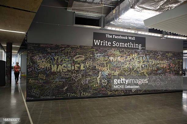 A wall that has been written on by employees stands in the entry way at Facebook office on April 23 2013 in Menlo Park United States