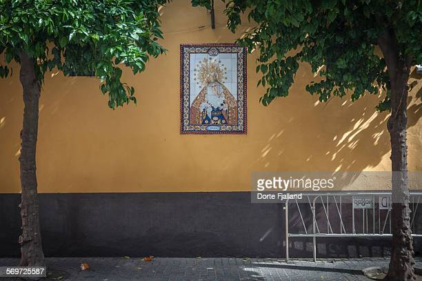 Wall with a tiled image of a holy virgin