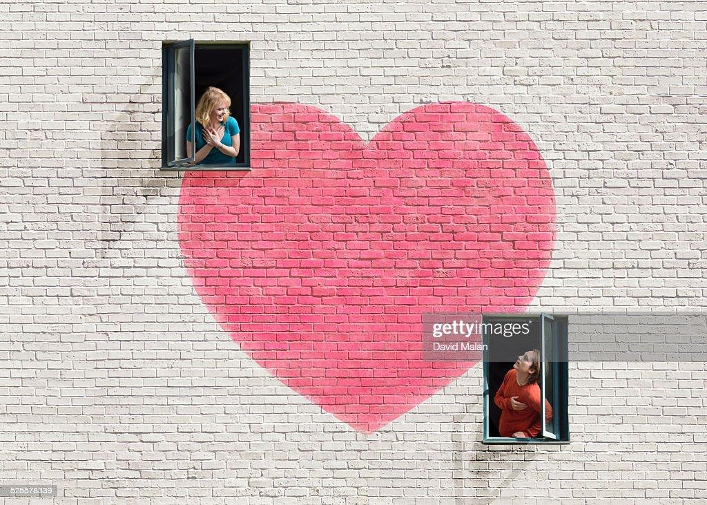 Wall with heart shape & windows & a couple : Stock Photo