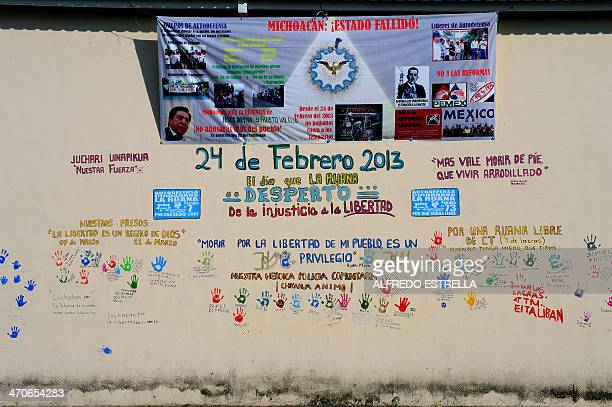 Wall with legends of supports to the socalled selfdefense groups at the La Ruana community Michoacan state Mexico on February 12 2014 Next February...