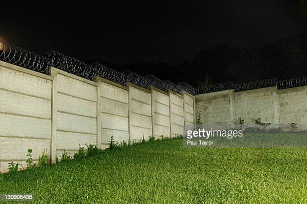 Wall with Razor Wire at Night