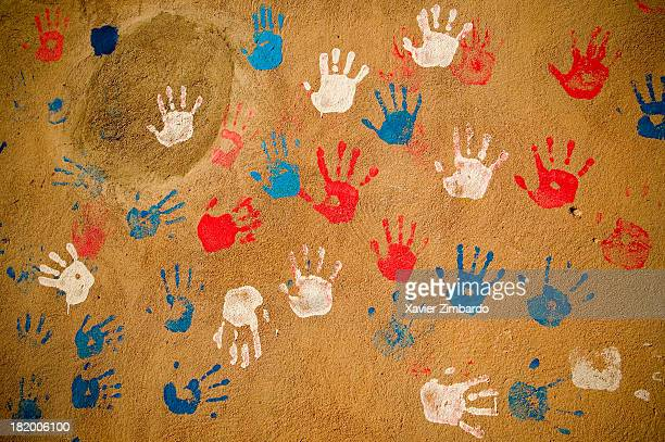 Wall with red blue and white handprints on February 1 2005 in the Moroccan Atlas Mountains Morocco