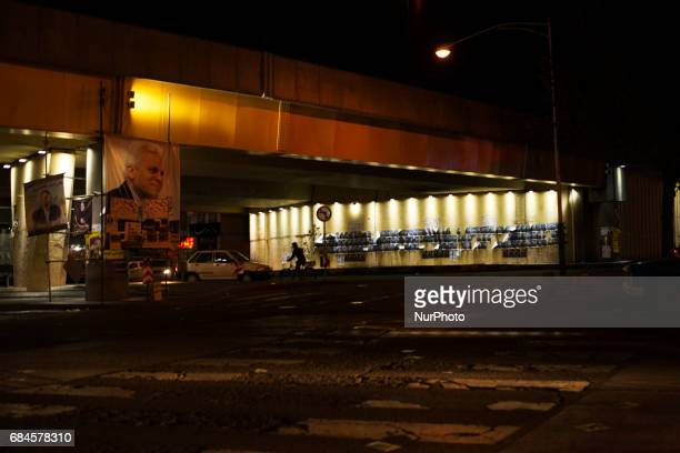 A wall with the photos of the candidates in Tehran Iran on 17 May 2017 President Rohani who is the left parties candidate He ran the country for 4...