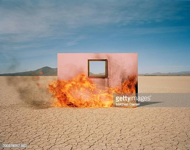 wall with window on fire in desert - smoking crack stock photos and pictures