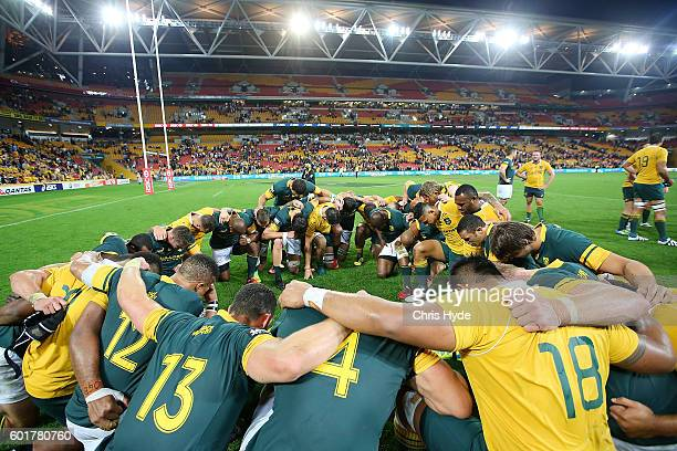 Wallabies and Sprinboks huddle after the Rugby Championship match between the Australian Wallabies and the South Africa Springboks at Suncorp Stadium...