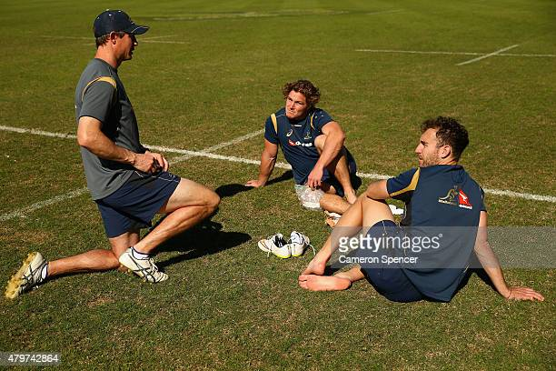 Wallabies assistant coach Stephen Larkham talks to Michael Hooper and Nic White of the Wallabies during an Australian Wallabies training session at...