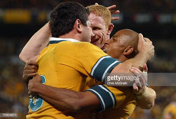 Wallabies captain George Gregan and John Roe congratulate Jeremy Paul after scoring a try during the rugby union international match between the...