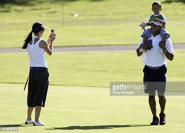 Wallabies captain George Gregan and son Max walk up the 13th fairway as wife Erica talkes a photo during the 2004 Australian PGA Championship ProAm...