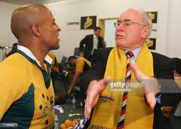 Wallabies captain George Gregan chats with Australian Prime Minister John Howard after defeating the Springboks during the Tri Nations series second...