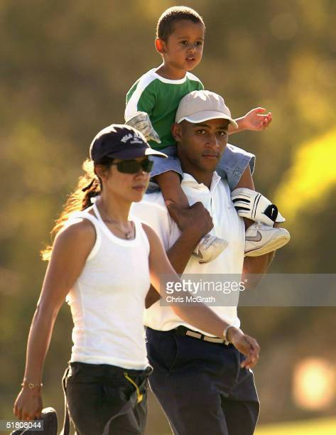 Wallabies captain George Gregan walks up the 13th hole with son Max and wife Erica during the 2004 Australian PGA Championship ProAm held at the...