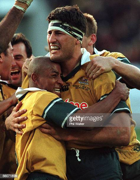 Wallabies captain John Eales right is hugged by George Gregan after defeating the All Blacks in the Bledisloe Cup/Tri Nations match at WestpacTrust...