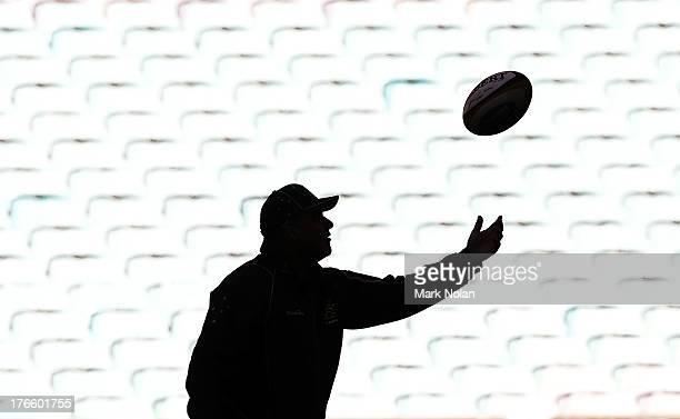 Wallabies coach Ewen McKenzie throws catches the ball during the Australian Wallabies Captain's Run at ANZ Stadium on August 16 2013 in Sydney...
