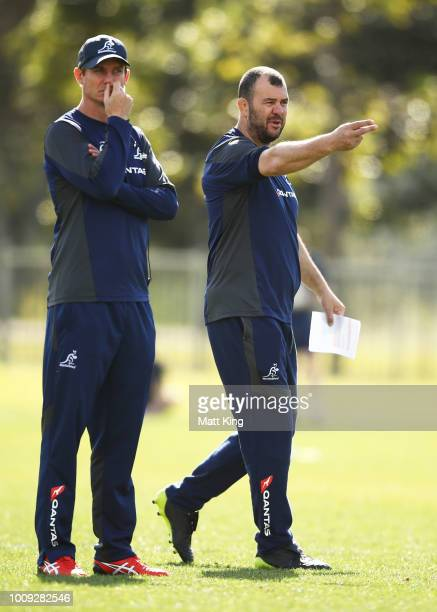 Wallabies coach Michael Cheika and attack coach Stephen Larkham talk to players during a Wallabies training session at Moore Park on August 2 2018 in...