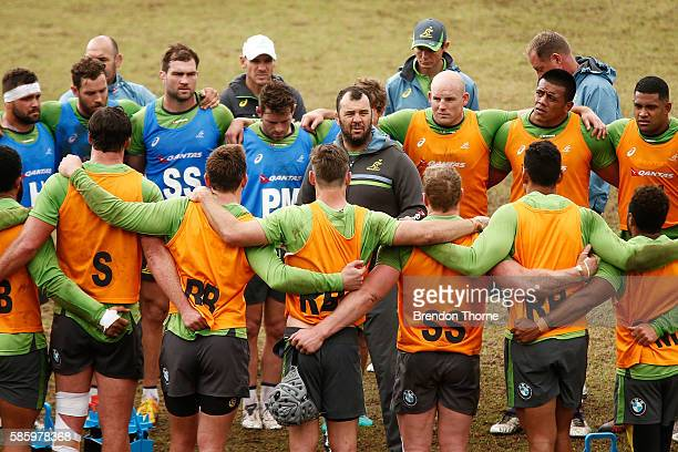 Wallabies Coach Michael Cheika speaks to his players during an Australian Wallabies media opportunity at Weigall Sports Ground on August 5 2016 in...