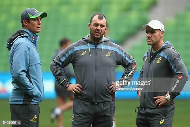 Wallabies coach Michael Cheika talks to assistant coaches Stephen Larkham and Nathan Grey during an Australian Wallabies Captain's Run at AAMI Park...