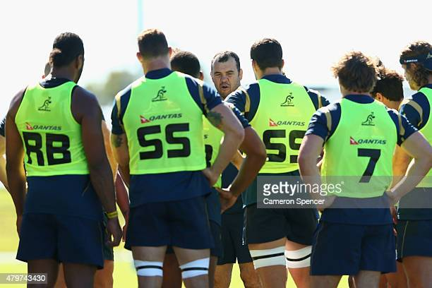 Wallabies coach Michael Cheika talks to players during an Australian Wallabies training session at Sunshine Coast Stadium on July 7 2015 in Sunshine...