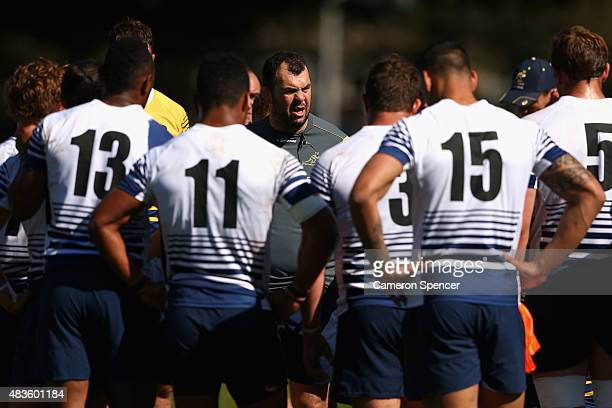 Wallabies coach Michael Cheika talks to players during an Australian Wallabies training session at Tramway Oval on August 11 2015 in Sydney Australia