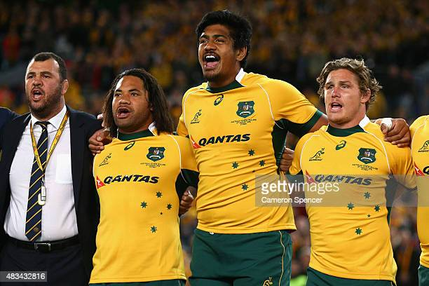 Wallabies coach Michael Cheika Tatafu PolotaNau Will Skelton and Michael Hooper of the Wallabies sing the Australian national anthem during The Rugby...