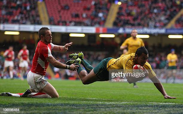 Wallabies full back Kurtley Beale beats Shane Williams to score during the Test match between Wales and the Australian Wallabies at Millennium...