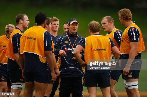 Wallabies head coach Robbie Deans talks to his players during an Australian Wallabies training session held at Manly Oval June 6 2008 in Sydney...