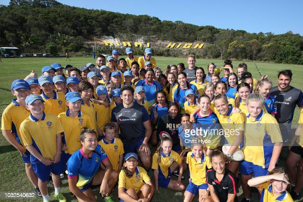 Wallabies players Adam Coleman Reece Hodge and Nick Phipps pose with students at Miami High School during an Australian Wallabies media opportunity...
