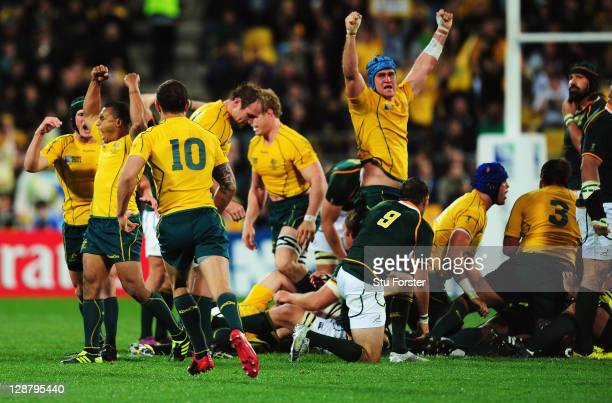 Wallabies players celebrate as the final whistle is blown and victory secured in quarter final three of the 2011 IRB Rugby World Cup between South...