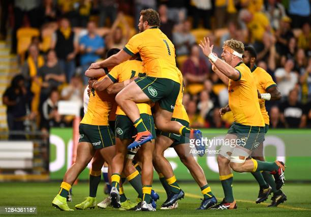Wallabies players celebrate Tom Wright try during the 2020 Tri-Nations match between the Australian Wallabies and the New Zealand All Blacks at...