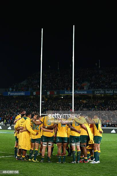 Wallabies players huddle after losing The Rugby Championship Bledisloe Cup match between the New Zealand All Blacks and the Australian Wallabies at...