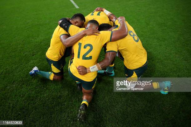 Wallabies players pray after winning the 2019 Rugby Championship Test Match between Australia and Argentina at Suncorp Stadium on July 27 2019 in...