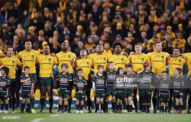 Wallabies players sing the national anthem during The Rugby Championship match between the Australian Wallabies and the Argentina Pumas at Canberra...