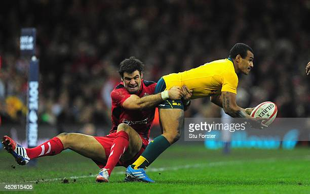 Wallabies scrum half Will Genia is tackled by Mike Phillips of Wales during the International match between Wales and Australia Wallabies at...