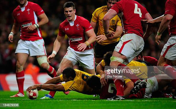 Wallabies scrum half Will Genia stretches to score the first Wallabies try during the Test match between Wales and the Australian Wallabies at...