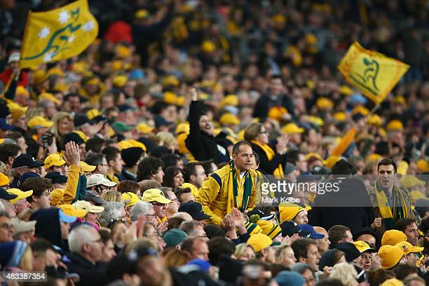 Wallabies supporters in the crowd cheer during The Rugby Championship match between the Australia Wallabies and the New Zealand All Blacks at ANZ...