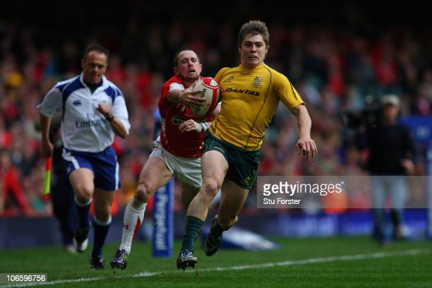 Wallabies winger James O' Connor outpaces Shane Williams to set up a score for Kurtley Beale during the Test match between Wales and the Australian...