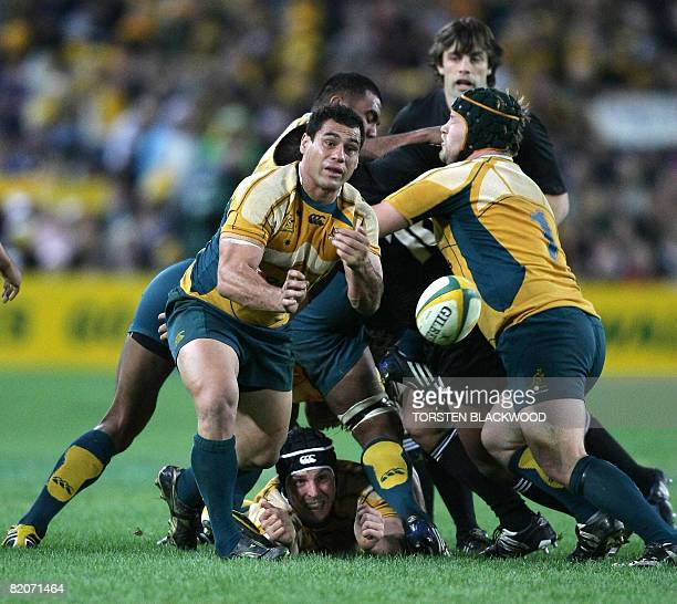Wallaby captain George Smith passes the ball during the Tri Nations Bledisloe Cup rugby union Test between Australia and New Zealand in Sydney on...