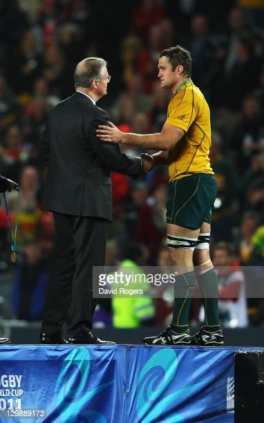 Wallaby captain James Horwill receives his bronze medal from IRB Chairman Bernard Lapasset during the 2011 IRB Rugby World Cup bronze final match...