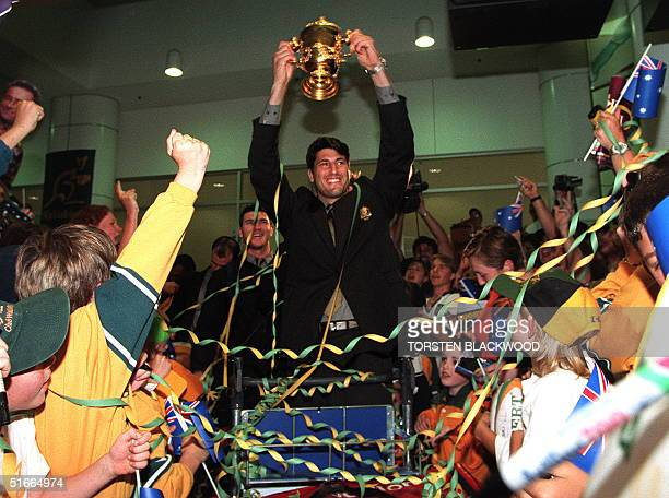 Wallaby captain John Eales gets a heroes welcome upon his return to Sydney 08 November 1999 after winning the rugby World Cup in Cardiff, Wales....