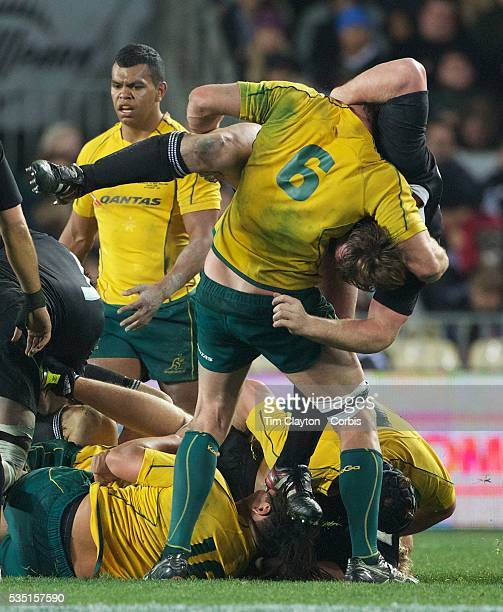 Wallaby captain Rocky Elsom grapples with All Black Andrew Hore at the break down during the New Zealand V Australia TriNations Bledisloe Cup match...